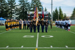 181207-N-SH284-0260 JOINT BASE LEWIS-MCCHORD, Wash. (Dec. 7, 2018) Army's Seventh Infantry Division Color Guard parades the colors while Army and Navy players stand in formation during the national anthem prior to the 19th annual Army/Navy flag football game at Joint Base Lewis-McChord's Cowan Stadium. The game, which is held ahead of the college football rivalry game between the U.S. Naval Academy and U.S. Military Academy, was won by Navy 20-14, marking the sixth consecutive victory for Navy and 13th victory in 20 games. (U.S. Navy photo by Mass Communication Specialist 2nd Class Vaughan Dill/Released)
