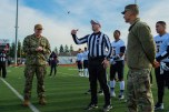 181207-N-SH284-0271 JOINT BASE LEWIS-MCCHORD, Wash. (Dec. 7, 2018) Capt. Alan Schrader, left, commanding officer of Naval Base Kitsap, calls the coin flip giving Navy the ball first during the 19th annual Army/Navy flag football game at Joint Base Lewis-McChord's Cowan Stadium. The game, which is held ahead of the college football rivalry game between the U.S. Naval Academy and U.S. Military Academy, was won by Navy 20-14, marking the sixth consecutive victory for Navy and 13th victory in 20 games. (U.S. Navy photo by Mass Communication Specialist 2nd Class Vaughan Dill/Released)